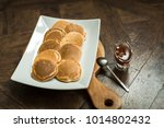 pancakes on a wooden board with ... | Shutterstock . vector #1014802432
