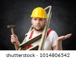 Small photo of Clumsy worker with tools