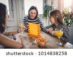 mother sitting at the wooden... | Shutterstock . vector #1014838258