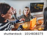 mother with two daughters... | Shutterstock . vector #1014838375