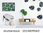 wooden cupboard with monstera...   Shutterstock . vector #1014839065