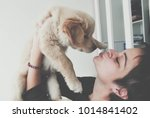 happy girl kissing her new... | Shutterstock . vector #1014841402