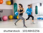 woman working out with the help ... | Shutterstock . vector #1014843256