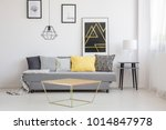 gold table in front of a gray... | Shutterstock . vector #1014847978