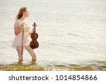 the blonde girl music lover on... | Shutterstock . vector #1014854866