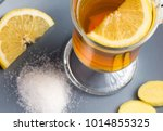 a cup of ginger tea with lemon... | Shutterstock . vector #1014855325