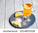 a cup of ginger tea with lemon... | Shutterstock . vector #1014855328
