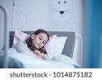 sad lonely girl lying in... | Shutterstock . vector #1014875182