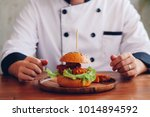 chef cooking beef burger on... | Shutterstock . vector #1014894592