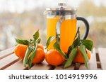 glass teapot with orange drink...   Shutterstock . vector #1014919996