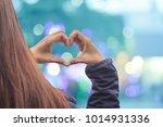 asian girl standing alone on... | Shutterstock . vector #1014931336