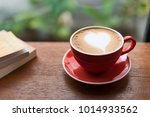 red cup of coffee with latte... | Shutterstock . vector #1014933562