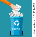 man hand throws garbage into a... | Shutterstock .eps vector #1014944776