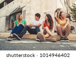 group of teenagers on the street | Shutterstock . vector #1014946402