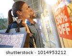 couple in front of shop window... | Shutterstock . vector #1014953212