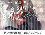 businessman presses currencies... | Shutterstock . vector #1014967438