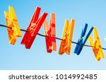 Stock photo plastic clothes pins laundry hook colorful pegs red yellow green orange blue sky outside 1014992485