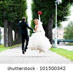 bride and groom is running with ... | Shutterstock . vector #101500342
