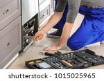 male technician repairing... | Shutterstock . vector #1015025965