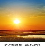 red sunset over river - stock photo