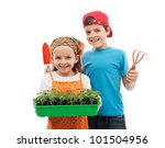 Happy spring gardening kids with seedlings and tools - isolated - stock photo