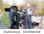 filming media event with a... | Shutterstock . vector #1015066318