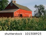 Green Corn Fields And Red Barn...