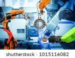 industrial robotic welding and... | Shutterstock . vector #1015116082