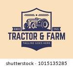 tractor logo or farm logo... | Shutterstock .eps vector #1015135285