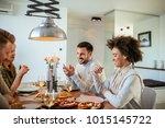 group of friends enjoying food... | Shutterstock . vector #1015145722