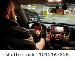 bearded man sits on driver seat ... | Shutterstock . vector #1015167358