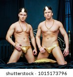 two men wearing golden... | Shutterstock . vector #1015173796
