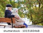 senior couple sitting on bench...   Shutterstock . vector #1015183468
