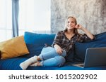 young woman at home in the... | Shutterstock . vector #1015202902