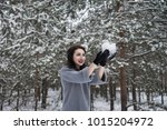 girl blows away the snow with... | Shutterstock . vector #1015204972