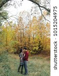 enamoured couple in the autumn... | Shutterstock . vector #1015204975