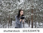 girl blows away the snow with... | Shutterstock . vector #1015204978