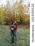 enamoured couple in the autumn... | Shutterstock . vector #1015205125