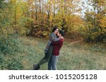 enamoured couple in the autumn... | Shutterstock . vector #1015205128
