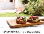 antipasti bruschetta with jamon ... | Shutterstock . vector #1015228582