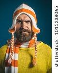 attractive bearded man in warm... | Shutterstock . vector #1015238065