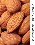 Small photo of Almond. Almonds macro. Almonds background. Almond nuts.Almond nuts texture closeup.Selective focus