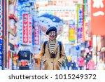 asian female traveler in japan   Shutterstock . vector #1015249372