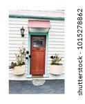 red door with plants | Shutterstock . vector #1015278862