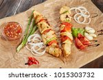 chicken meat kebab with sauces... | Shutterstock . vector #1015303732