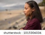 young black woman looking into... | Shutterstock . vector #1015306036