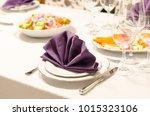 purple napkin on a table setup  | Shutterstock . vector #1015323106