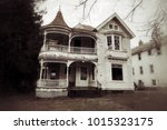 abandoned and neglected house... | Shutterstock . vector #1015323175