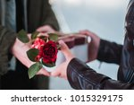 man gives present to her... | Shutterstock . vector #1015329175