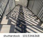 light and shadow on street walk   Shutterstock . vector #1015346368